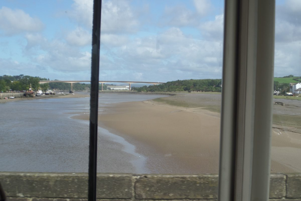 The view downstream from the middle of the old Bideford Bridge with new high-level Torridge Bridge in the distance.