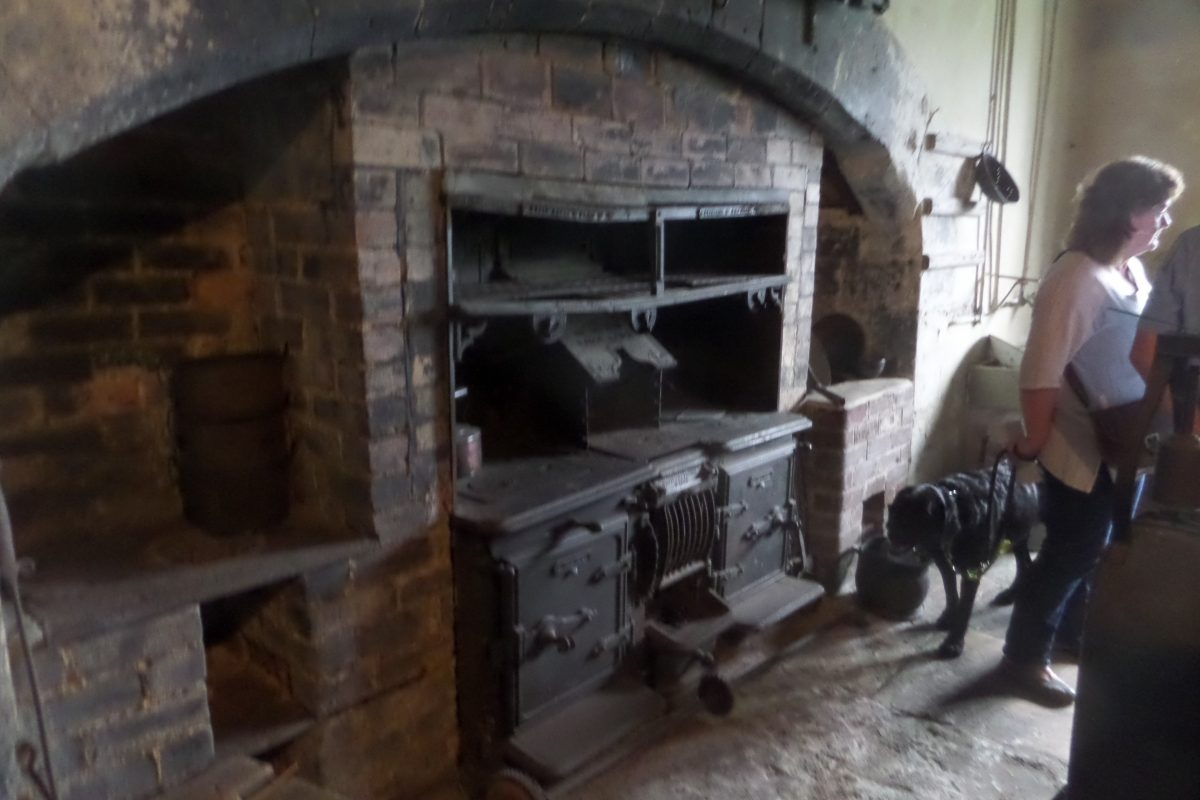 "The old kitchen at Chastleton House showing the ""new"" range installed in the 19th century. Photo is fuzzy as it is rather dark in the house."